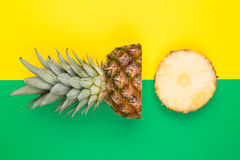 Tropical pineapples on green and yellow background Stock Image