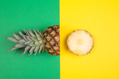Tropical pineapples on green and yellow background Stock Photo