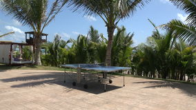 Tropical Ping Pong Table Pan. Paradise comes complete with outdoor table tennis stock video footage