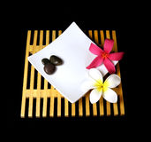 Tropical plumeria flowers on a wooden grid Stock Photos