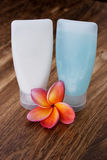 Tropical Plumeria and Toiletries for spa Royalty Free Stock Images