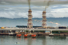 Tropical polluting power plant. Stock Photo
