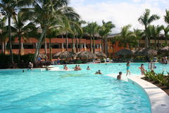 Tropical Pool. Tourists swimming in a tropical resort pool Stock Images