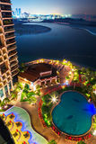 Tropical pool area at night Royalty Free Stock Photo
