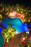 Tropical pool area at night Royalty Free Stock Image