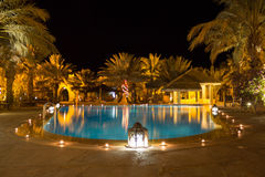 Tropical pool at night Stock Photo