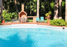 Tropical Pool and Patio Royalty Free Stock Images