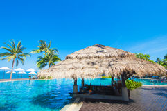 Tropical pool and bar beside the sea Stock Images