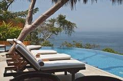 Tropical pool setting Royalty Free Stock Photo