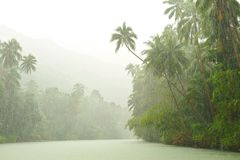 Tropical rain above river Stock Photo