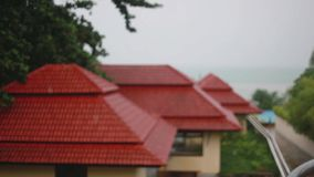 Tropical rain drops falling on roof of the houses in island Koh Samui, Thailand. Seaview. 1920x1080 stock video footage