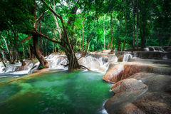 Tropical rain forest jangles with Kuang Si waterfall. Laos Stock Images