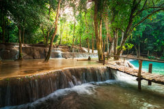 Tropical rain forest jangles with Kuang Si waterfall. Laos Royalty Free Stock Photos