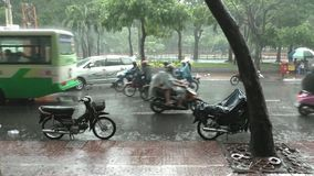 Tropical Rain in Ho Chi Minh City, Vietnam. Central street with transport under the rain in Ho Chi Minh City, Vietnam stock footage