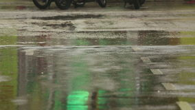 Tropical rain, Phuket. Close-up of people footsteps. Puddles after rain stock footage