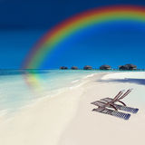 Tropical Rainbow Island. Bungallows in a Tropical Rainbow Island Royalty Free Stock Photos