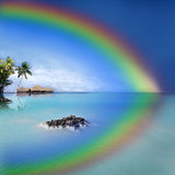 Tropical Rainbow Island. Bungallows in a Tropical Rainbow Island Stock Photo