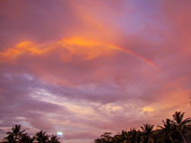 Tropical rainbow at sunset. Rainbow on a tropical beach at sunset in Phuket, Thailand Stock Images