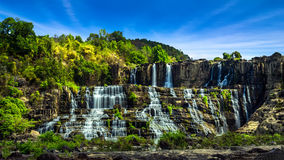 Tropical rainforest landscape panorama with flowing Pongour wate Royalty Free Stock Photography