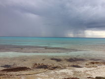 Tropical rainstorm out at sea Stock Photos