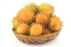 Tropical Rambutan Fruits. Rambutan Fruits in a rattan basket on white back ground Royalty Free Stock Photography