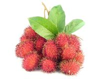 Tropical Rambutan Fruits. Red Rambutan Fruits with leaf on white back ground Royalty Free Stock Image