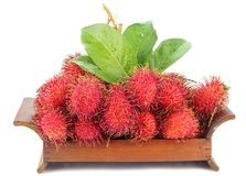 Tropical Rambutan Fruits. Rambutan Fruits in a wooden platter on white back ground Royalty Free Stock Photography