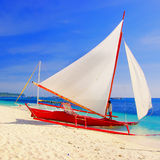 Tropical recreations. Beautiful tropical scene with sail boat Royalty Free Stock Images