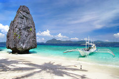 Tropical recreations. Beautiful tropoical landscape with rock and boat Royalty Free Stock Image