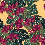 Tropical red hibiscus flowers and monster leaves seamless pattern. Palm tree leaves decoration on yellow background. Colorful exotic rainforest wallpaper Stock Photos
