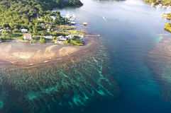 Tropical reef. An aerial view of a tropical resort with fantastic reefs and clear water on Roatan Island, Honduras Royalty Free Stock Image