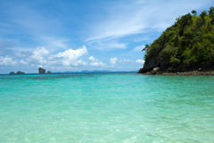 Tropical remote island in the ocean. Perfect sky and Tropical remote island in the ocean Royalty Free Stock Image