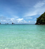 Tropical remote island in the ocean. Perfect sky and Tropical remote island in the ocean Stock Photography