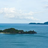 Tropical remote island in the ocean Royalty Free Stock Image