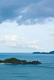 Tropical remote island in the ocean Stock Photos
