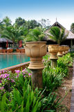 Tropical resort. Swimming pool at a tropical resort in Thailand - travel and tourism Royalty Free Stock Photo