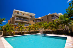 Tropical Resort. A popular tropical resort with a view from the pool toward the building's exterior Stock Images