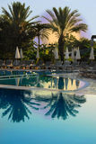 Tropical resort. Sun above swimming pool on Mediterranean seaside at summer resort in Turkey Stock Image