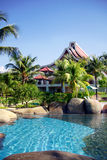 Tropical resort. Swimming pool and houses of tropical resort Stock Photography