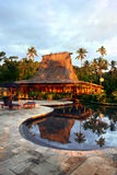 Tropical resort. Swimming pool and bar-hut in tropical resort. Beautiful sunset Stock Photography