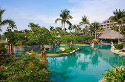 Tropical resort. Luxury swimming pool at tropical resort Stock Photography