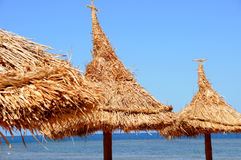 Tropical resort. Umbrellas by the sea Stock Photography