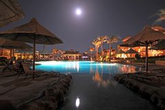 Tropical Resort. A beautiful view of a tropical resort on a night with full moon in the sky Stock Images