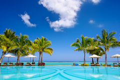 Tropical resort. Tropical beach resort with  lounge chairs and umbrellas in Mauritius Stock Image
