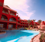 Tropical resort. Beautiful red hotel with a swimming pool in Egypt Royalty Free Stock Image