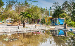 Tropical resort bungalow with pond in Thailand. Wide view of beautiful tropical resort bungalow with pond in Thailand Royalty Free Stock Photos