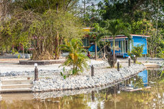 Tropical resort bungalow with pond in Thailand Stock Image