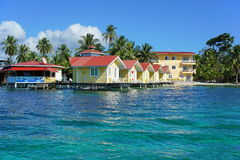 Tropical resort with cabin over water. Of the Caribbean sea, Carenero island, Bocas del toro, Panama, Central America Stock Photos
