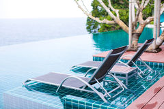 Tropical resort. Deck chairs at a tropical resort in Thailand - travel and tourism image Stock Image