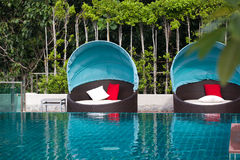 Tropical resort. Deck chairs at a tropical resort in Thailand - travel and tourism image Stock Photography